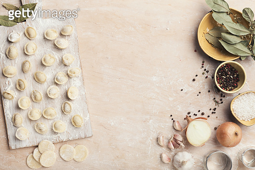 Dumplings on the table with flour, layout for recipe