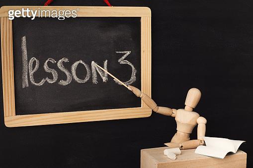 Lesson 3 written with chalk on blackboard.