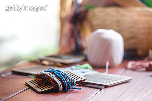 Hand-woven cotton is a folk wisdom.The device consists of Weaving shuttle, Hand loom ,weaver.Delicate pattern