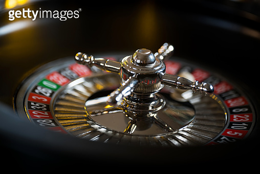 High contrast image of casino roulette and poker chips