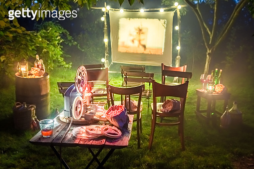 Small cinema with old analog films in summer evening