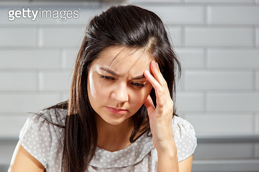 Young woman with a headache holding head. Headache, Women, Emotional Stress