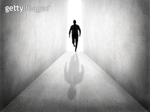 Man Walk From Bright Light. Hope Concept