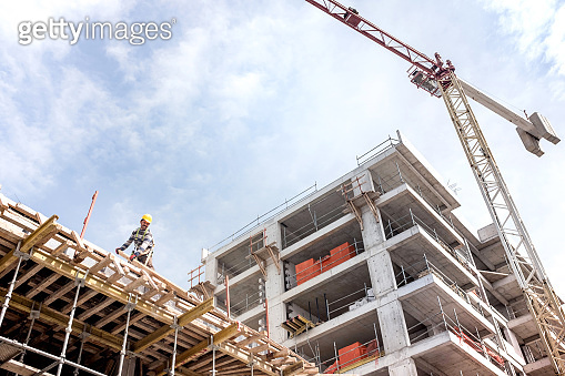 Construction Site View With Tower Crane