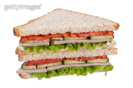 sandwich on toasted bread with ham and cucumber, tomato and lettuce, on white background, isolate