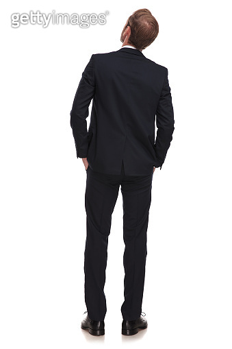 back view of relaxed businessman looking up to side