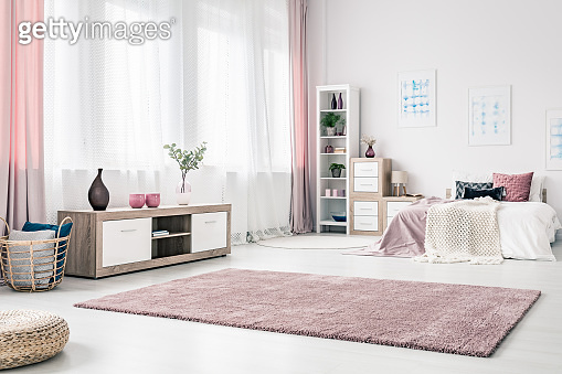 Drapes in spacious pink bedroom