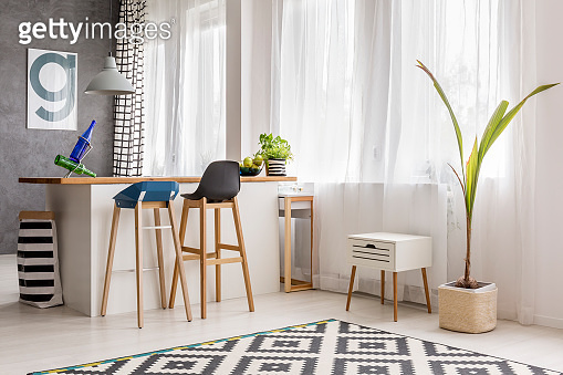 Simple dining area with plant