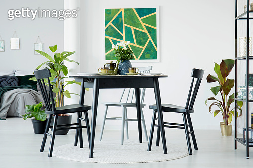Dining room with green painting