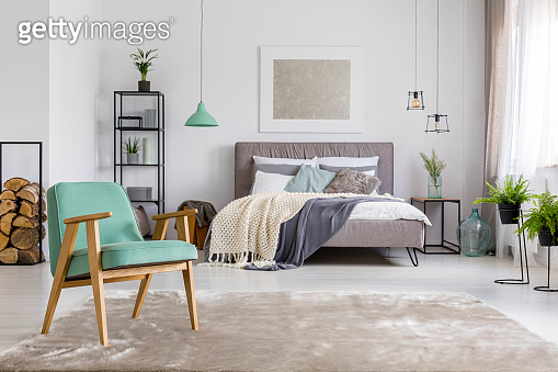 Spacious bedroom with armchair