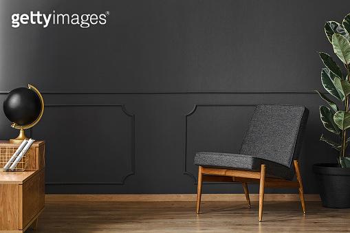 Spacious, black retro room interior