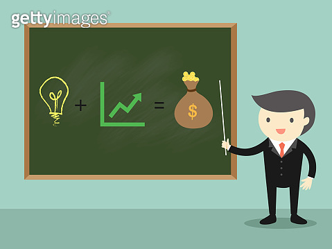 Businessman standing in front of chalkboard.