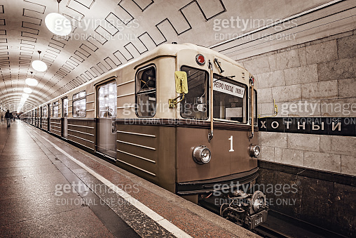 Retro subway train stands by the platform of Ochotnyi rjad station.