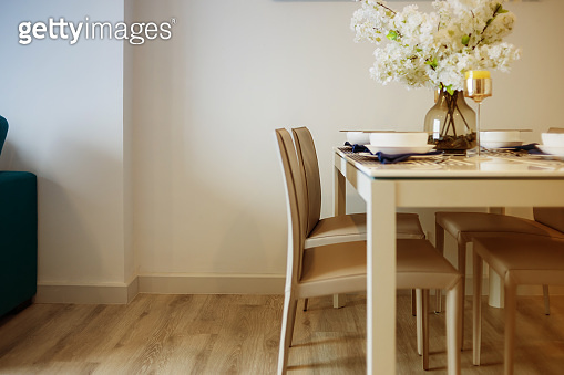 dining room with wood floor and white wall background