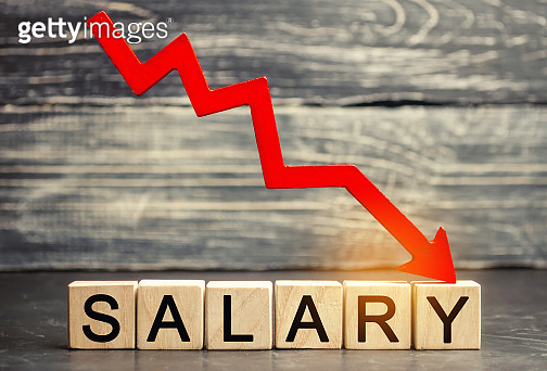 The inscription salary and the red arrow down. lower salary, wage rates. demotion, career decline. lowering the standard of living. wage cuts. decrease in profits and family budget