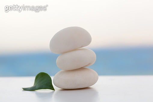 Rock cairn on tropical beach.