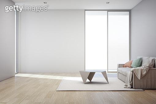 Wooden floor with empty gray concrete wall background in living room at modern new house, Glass window and door of white office or natural light studio.