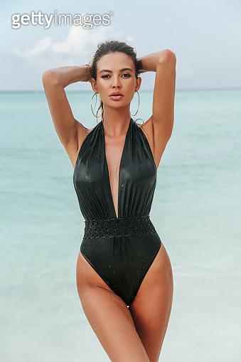 sexy woman with blond hair in luxurious bikini relaxing on Maldive island