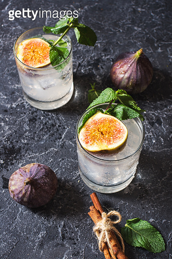 Pink fig alcoholic cocktail with cinnamon and mint