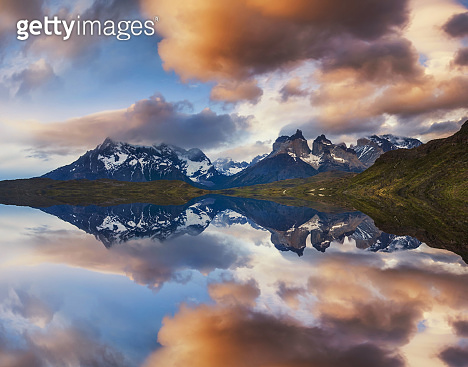 Majestic mountain landscape. Reflection of mountains in the lake. National Park Torres del Paine
