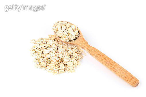 Oatmeal in wooden spoon isolated on white background