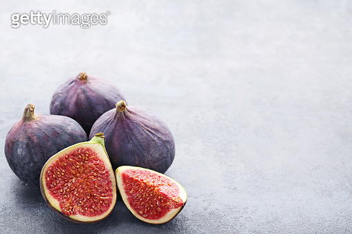 Ripe and sweet figs on wooden table