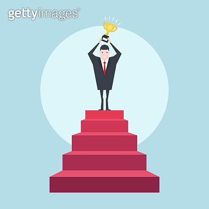 Successful businessman on top of the stairs with the trophy. Business concept.