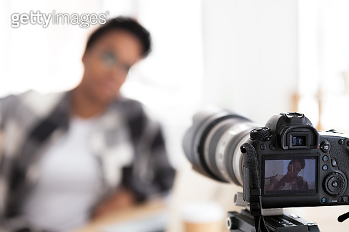 Young black female blogger on camera screen