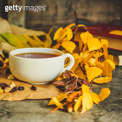 Tea - a cup of tea is brewed tea bag. cup on the table and yellow leaves. top view.