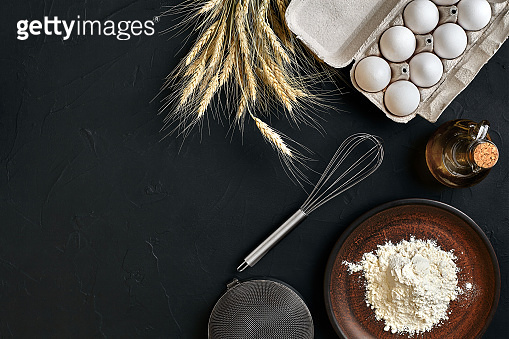 Preparation cooking baking kitchen table brown dishes ware fresh grocery different ingredients: eggs, flour, oil, stuff top view