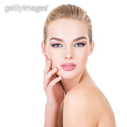 Young beautiful woman with health skin of a face.