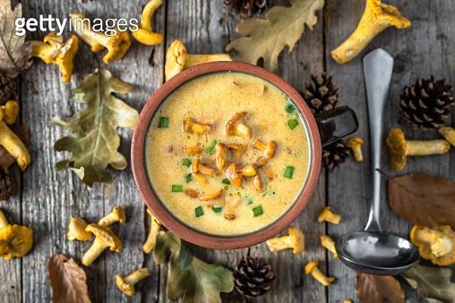 Cream soup - mushroom dish, overhead on wooden background