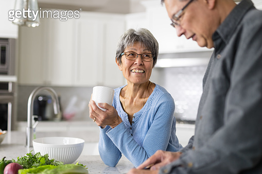 A senior couple makes lunch together