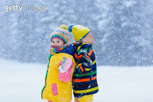 Kids playing in snow. Children play in winter.