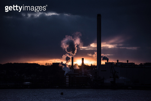 Power plant steam fumes at sunset