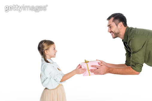 side view of father presenting gift to little daughter isolated on white, international womens day concept
