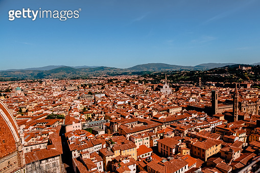 aerial view of beautiful cityscape with historic buildings and rooftops in florence, italy