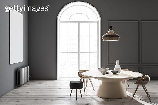 Dark gray dining room, wooden table