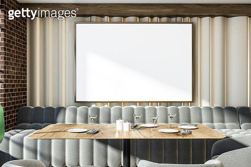 Brick wall gray sofas restaurant interior, poster