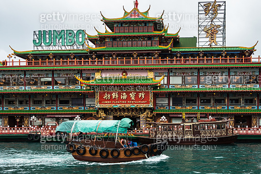 A traditional chinese sampan boat and Jumbo floating restaurant, one of the most famous landmark of Hong Kong, Aberdeen