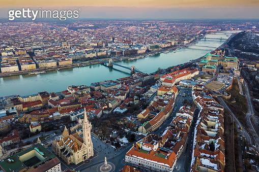 Budapest, Hungary - Aerial shot of beautiful Matthias Church with Fisherman's Bastion, Buda Castle Royal Palace and Szechenyi Chain Bridge