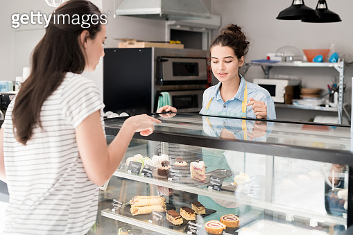 Young Woman Working in Cake Shop