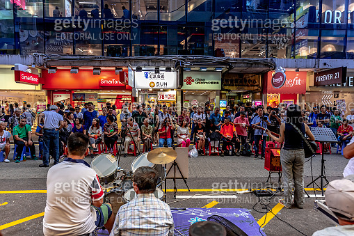 Last Weekend of the pedestrianisation scheme for street performers on SAI YEUNG CHOI STREET SOUTH in MongKok, HONG KONG.