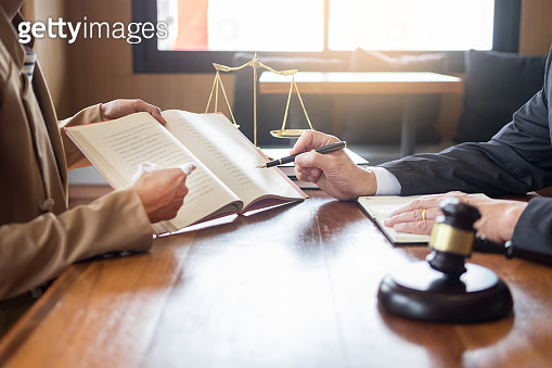 lawyer in office. Counseling and giving advice about legal legislation in courtroom to help customer, tribunal and justice concept