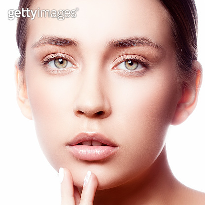 Close-up beauty girl face with natural nude make up and perfect skin