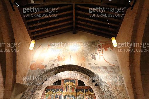 The fresco over the altar in the Romanesque Ermita de la Virgen del Castillo (Castle Virgin Church) in the Monterde rural town, in Aragon, Spain