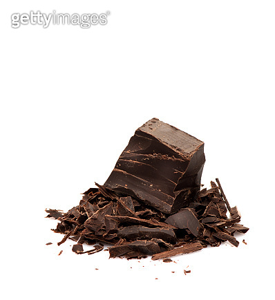 Pieces and chopped chocolate isolated on white background