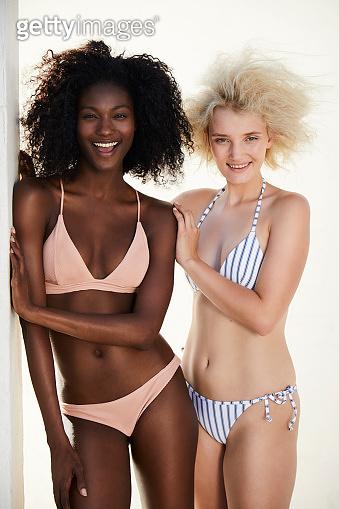 Laughing bikini women