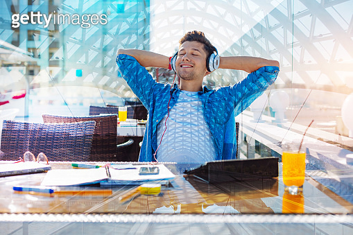 Cheerful man relaxing with his eyes closed