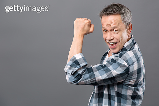 Delighted cheerful man smiling to you